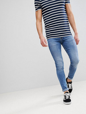 ASOS Super Skinny Jeans In Mid Wash Blue