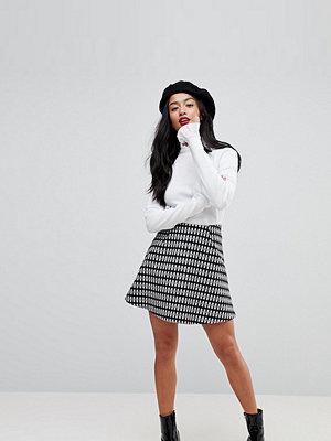 ASOS Petite Rutig minikjol i vippig modell Mono