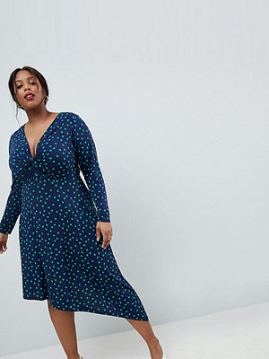ASOS Curve ASOS DESIGN Curve midi dress in polka dot with knot front and asymmetric hem