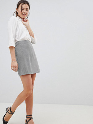 ASOS DESIGN a-line mini skirt in dogtooth check