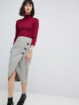 ASOS DESIGN tailored midi skirt in check with button wrap detail