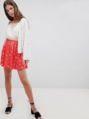 ASOS DESIGN mini skater skirt in red floral
