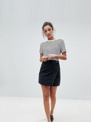 Asos Tall ASOS DESIGN Tall denim wrap skirt in washed black - Washed black