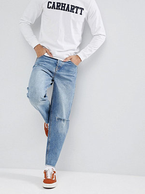 ASOS DESIGN Skater Jeans In Mid Wash Blue With Rips