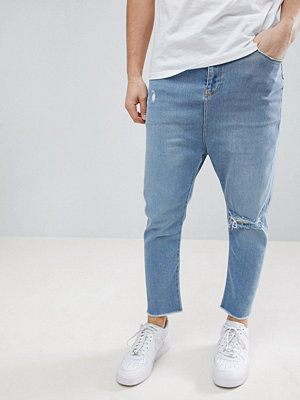 ASOS Drop Crotch Jeans In Light Wash Blue With Rips
