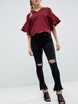 Parisian Skinny Jeans with Knee Rips and Distressed Flare Hem