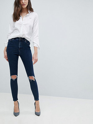 ASOS DESIGN Ridley high waist skinny jeans in viola deep blue wash with busted knees - Mid wash blue