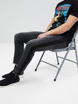 ASOS Super Skinny Jeans In Washed Black With Side Stripe And Knee Rips