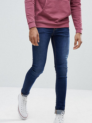ASOS TALL Extreme Super Skinny Jeans In Dark Wash