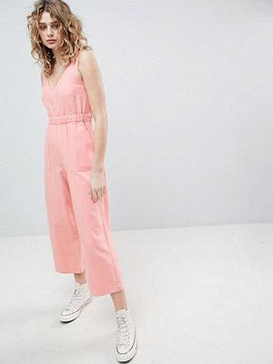 ASOS DESIGN denim jumpsuit with v neck in washed pink
