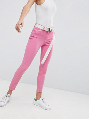 ASOS DESIGN Ridley high waist skinny jeans in neon pink with extra long belt