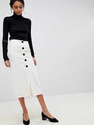 ASOS DESIGN midi skirt with contrast buttons - Ivory