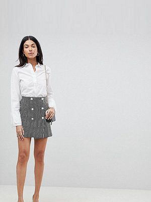 Asos Tall ASOS DESIGN Tall double breasted mini skirt In stripe - Black / white