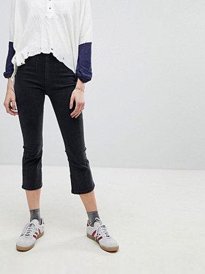 Free People Ultra High Kick Utsvängda jeans