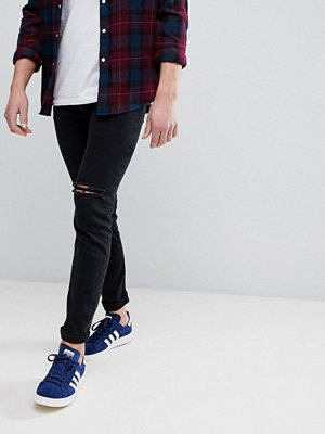 ASOS Skinny Jeans In Black With Knee Rips