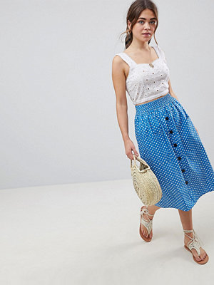 ASOS DESIGN cotton midi skirt with button front in spot