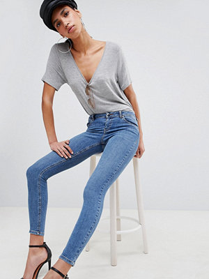 ASOS DESIGN Whitby Low Rise Skinny Jeans In Venezia Blue - Mid wash blue