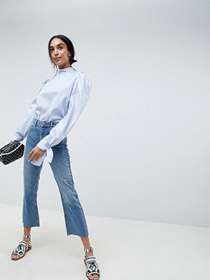 ASOS DESIGN Authentic Rigid Cropped Flare Jeans In Vintage Mid Wash