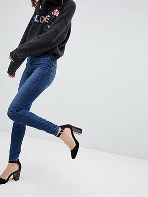 Vero Moda Skinny jeans med hög midja och extra smal passform Mellanblå