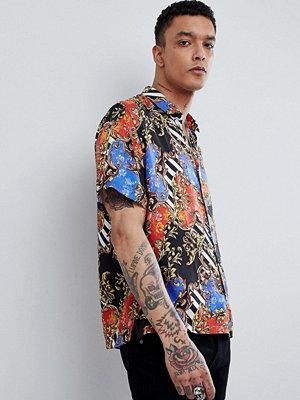 ASOS DESIGN oversized chain print shirt with revere collar