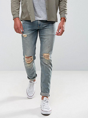 ASOS Stretch Slim Jeans In Vintage Mid Wash With Knee Rips