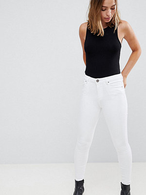 ASOS Petite RIDLEY High Waist Skinny Jeans In Optic White