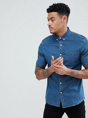 ASOS DESIGN stretch slim denim shirt in mid wash