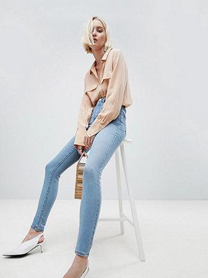 ASOS DESIGN 'Sculpt Me' High Rise Premium Jeans In Antoinette Mid Wash Blue