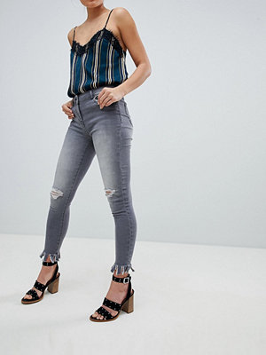 Parisian Skinny Jeans with Knee Rips and Distrssed Hem