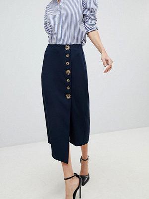 ASOS DESIGN side button pencil skirt with asymmetric hem