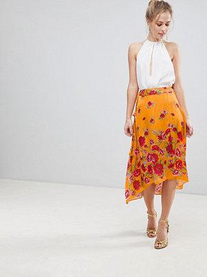 ASOS DESIGN satin wrap midi skirt in floral print