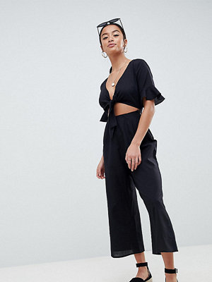 ASOS Petite ASOS DESIGN Petite tea jumpsuit with cut out and tie detail in linen