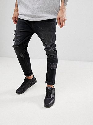 Jeans - ASOS DESIGN Drop Crotch Jeans In Washed Black With Heavy Rips