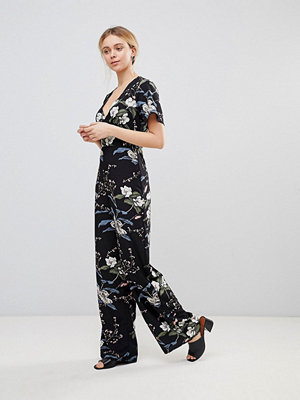 Girls on Film Jumpsuit med kimonoärmar Black floral print