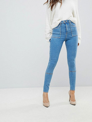 ASOS DESIGN Ridley high waist skinny jeans with painter styling in lily pretty wash - Mid wash blue