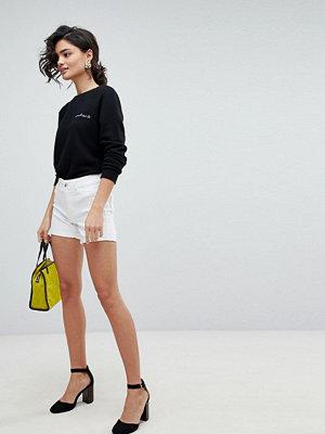 Vero Moda Shorts med uppvikt nederkant