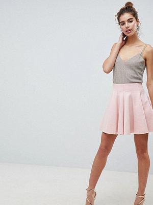 ASOS DESIGN scuba mini skirt with high waist and box pleat