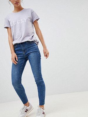 New Look Jeans i skinny fit med dekorativ söm Blekblå