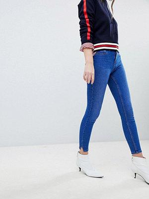 New Look Jenna Skinny jeans med fransiga benslut