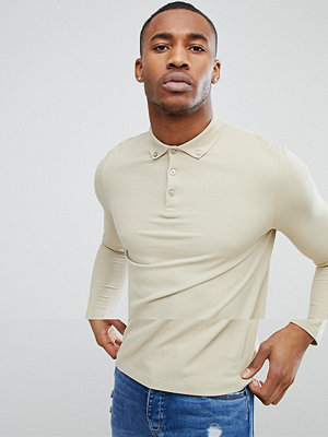 ASOS DESIGN pique long sleeve polo with button down collar in beige - Chips