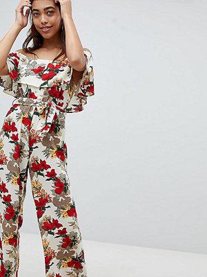 PrettyLittleThing Exclusive blommig jumpsuit med knytning i midjan och singoallaringning