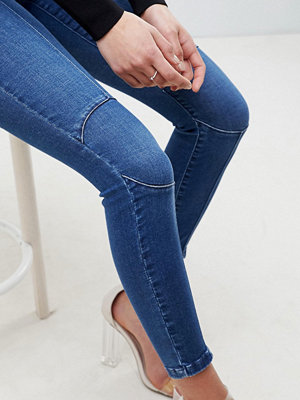 ASOS DESIGN Ridley High Waist Skinny Jeans With Circluar Moto Knee Detail In Dark Wash Blue - Mid wash bl