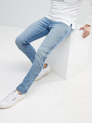 ASOS Skinny Jeans In Mid Wash Blue With Popper Detail - Mid wash blue