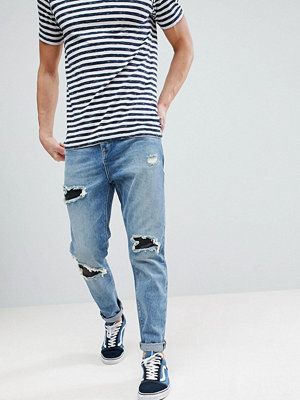 ASOS Tapered Jeans In Mid Wash Vintage With Faux Leather Rip & Repair - Mid wash vintage