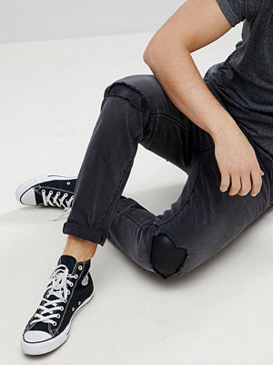 ASOS Tapered Jeans In Washed Black With Faux Leather Rip & Repair - Washed black