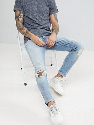 ASOS Skinny Jeans In Vintage Light Wash Blue With Rips - Light wash vintage