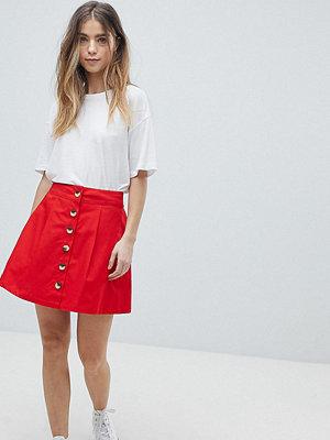 ASOS Petite ASOS DESIGN Petite cotton mini skater skirt with button front
