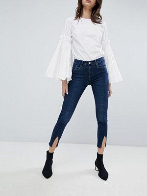 River Island Amelie Skinny jeans med slits framtill Mörk färg