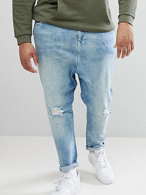 ASOS DESIGN Plus Drop Crotch Jeans In Mid Wash Blue With Rips - Mid wash blue
