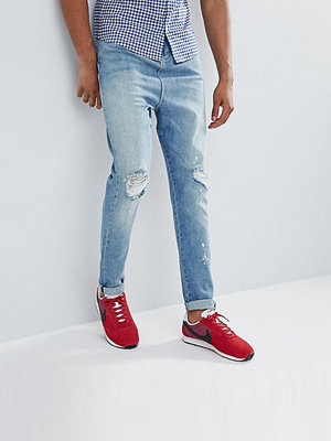 ASOS DESIGN Tall Drop Crotch Jeans In Mid Wash Blue With Rips - Mid wash blue